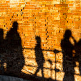 people-walking-casting-shadows-wall-old-italian-city-venice-can-see-tourists-sunset-51738652